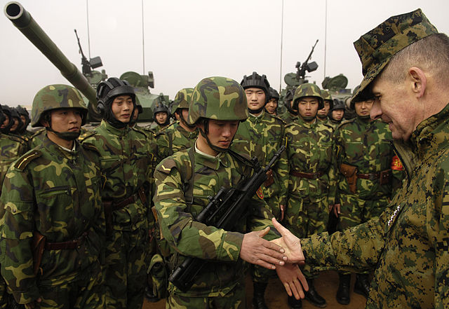 Peter_Pace_shakes_hands_with_a_Chinese_soldier_(Shenyang_Base,_China,_March_24_2007)