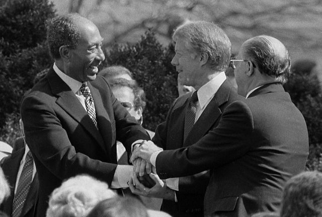 640px-Sadat_Carter_Begin_handshake_(cropped)_-_USNWR