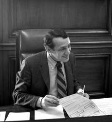 Harvey_Milk_in_1978_at_Mayor_Moscone's_Desk_crop