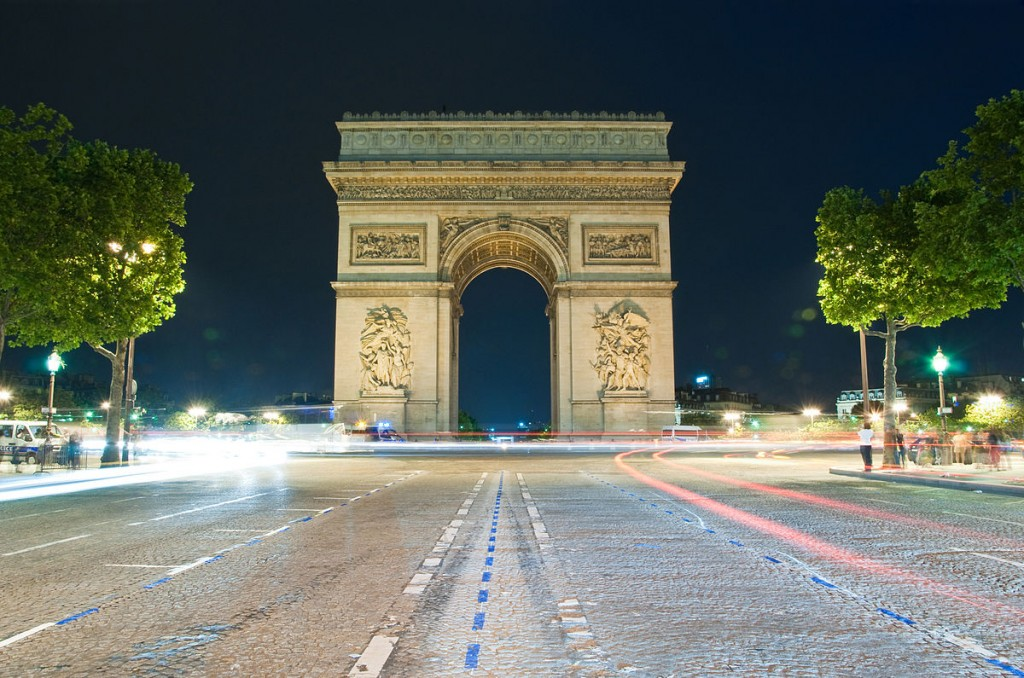1200px-Arc_by_night,_Paris_27_June_2012